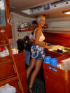 Marquesas Passage - Signe bracing herself in the galley - 98K